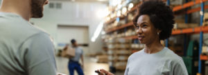 Header - Workers Compensation Insurance - Warehouse Workers Moving Boxes